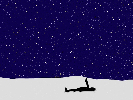 Person laying in the snow giving the constellations a thumbs up